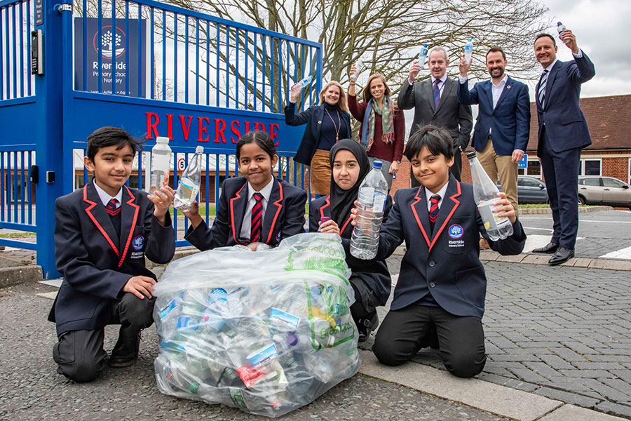 Local school kids celebrating with their recycling efforts