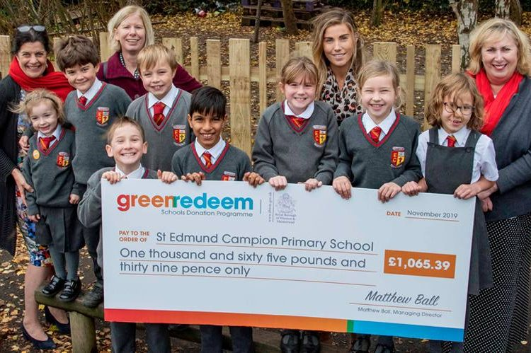 Group of school kids holding large cheque