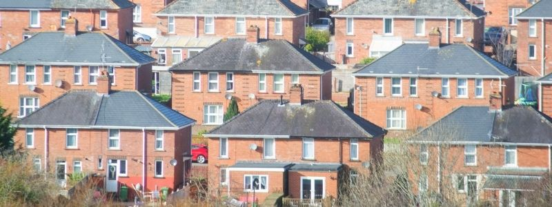 A raised view of redbrick semi-detached homes